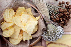 Potato chip on wood background Royalty Free Stock Photography