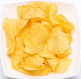 Potato chips. Tasty potato chips in a white dish Royalty Free Stock Photography