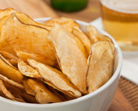 Potato chips. Rustic homestyle kettle cooked potato chips royalty free stock images
