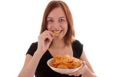 Potato chips. A young woman eating potato chips Stock Image