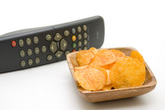Potato chips. With remote control Royalty Free Stock Photos