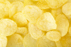 Potato chips. Fried food background Stock Photos