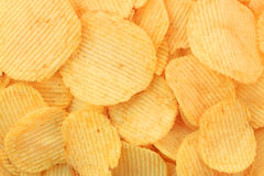 Potato chips. Golden potato chips background (rippled Stock Photo