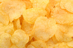 Potato chips. Golden potato chips close-up background Stock Photos