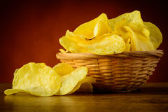 Potato chips. Still life with tasty traditional potato chips snacks Royalty Free Stock Photography