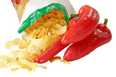 Potato Chips. With red paprika on white background royalty free stock photo
