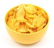 Potato chips. In bowl, on white stock image