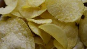 Potato chips background. Crispy potato chips rotating, macro background stock footage