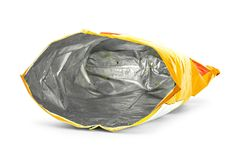 Potato chips bag isolated on white background. Inside of leftovers snack packaging royalty free stock photography