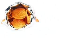 Potato chips in bag. Royalty Free Stock Image