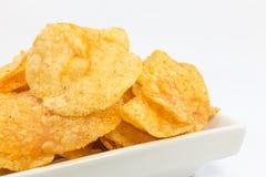 Potato chips barbecue flavour. Stock Photos