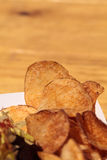 Potato chips in a basket Royalty Free Stock Image