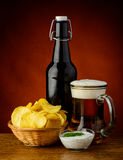 Potato chips and beer Royalty Free Stock Photos