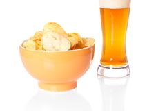 Potato chips and beer Royalty Free Stock Image