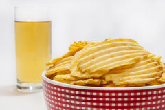 Potato chips with beer in the glass Stock Photo