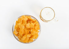 Potato chips with beer glass Stock Image