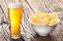Potato chips and beer. Stock Photography