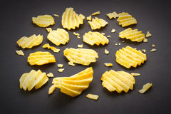Potato chips. On a black background Royalty Free Stock Images