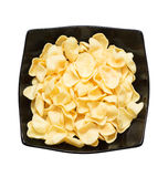 Potato chips on a black plate Royalty Free Stock Image