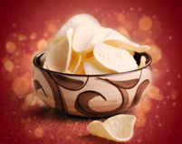 Potato chips in bowl Stock Photography