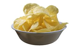 Potato chips in a bowl. A bowl full of potato chips stock photos