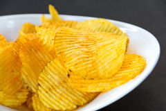 Potato chips in bowl Stock Image
