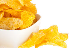 Potato Chips in a bowl (with clipping path). Group of potato chips in a white bowl isolated on white background (with clipping path Royalty Free Stock Images