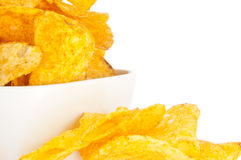Potato Chips in a bowl (with clipping path). Group of potato chips in a white bowl isolated on white background (with clipping path Stock Images
