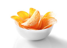 Potato chips in bowl close-up on white Stock Photography