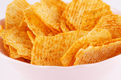 Potato chips in bowl Stock Images
