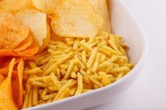Potato chips in bowl Stock Photo
