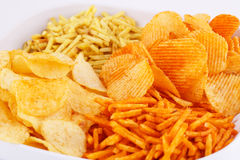 Potato chips in bowl Stock Photo