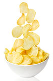 Potato chips bowl isolated on white Royalty Free Stock Photos