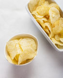 Potato chips bowl isolated on white Stock Images