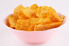Potato chips in bowl Stock Photos
