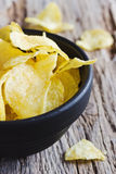 Potato chips. In a bowl on the table Stock Images