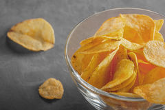 Potato chips in bowl with a tomato juice in glass Stock Photos