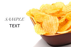 Potato Chips in bowl on white Stock Image