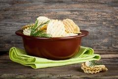 Potato chips in bowl Stock Photos