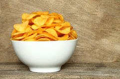 Potato chips bowl on a wooden background Royalty Free Stock Photos