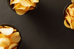 Potato chips bowls background with copy space, top view. stock photo