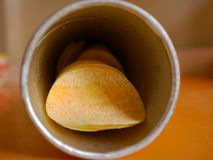 Potato chips. Potato chip  in a paper cylindrical bottle Stock Photo