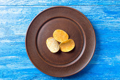 Potato chips in a clay plate Stock Image
