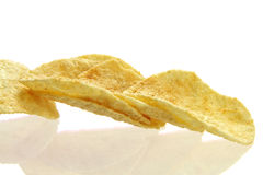 Potato chips. Close up of  fried potato chips isolated on  white background Royalty Free Stock Images