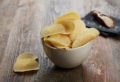 Potato chips closeup. Potato chips on table closeup stock photography