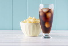 Potato chips and cola Stock Photo