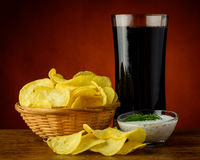 Potato chips and cola drink Stock Photos