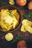 Potato chips in a cup on a dark background, top view, tinted Royalty Free Stock Photography