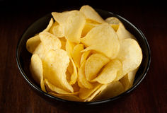 Potato chips on dark background - snack bar menu Royalty Free Stock Photos