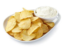 Potato chips and dip. Plate of potato chips and dip isolated on white background Royalty Free Stock Image